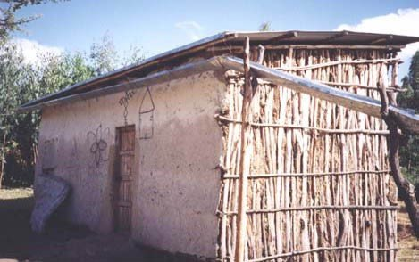 <p><b>A simple arrangement to solve the problem with a tank situated on the wrong side of a single pitched roof</b> in Ethiopia. Note the excellent slope of the gutter which is obtained by tying it to splashguard nailed onto the roofing sheets.</p>      <p>© E. Nissen-Petersen, Kenya</p>