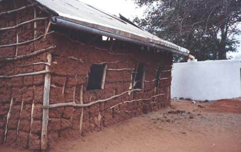 <p><b>Gutter suspended with a straight slope from a splash-guard nailed onto an uneven roof</b></p>      <p>© E. Nissen-Petersen, Kenya</p>