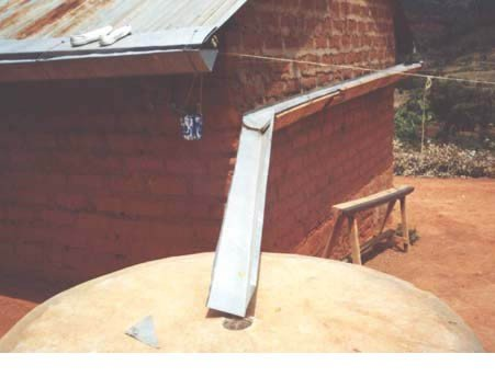 <p>Here the <b>gutter is too short and slopes away from tank</b></p>      <p>© E. Nissen-Petersen, Kenya</p>