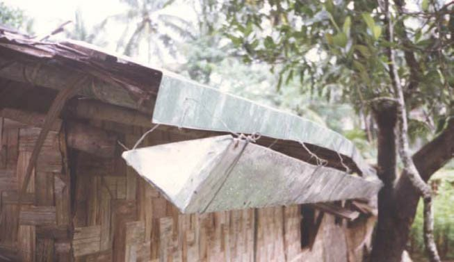 <p>Gutters fitted into hangers tied to a splash-guard nailed onto an uneven roof</p>      <p>© E. Nissen-Petersen, Kenya</p>