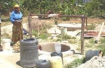 <p>A woman <b>financing the digging of her hand-dug well </b>by selling water from the well.</p>      <p>(c) E. Nissen-Petersen, Kenya</p>
